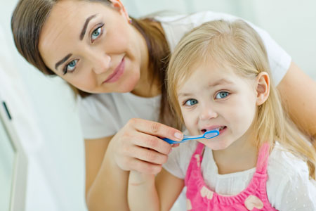 Mom and Daughter brushing their teeth - Pediatric Dentist in Marble Falls, TX